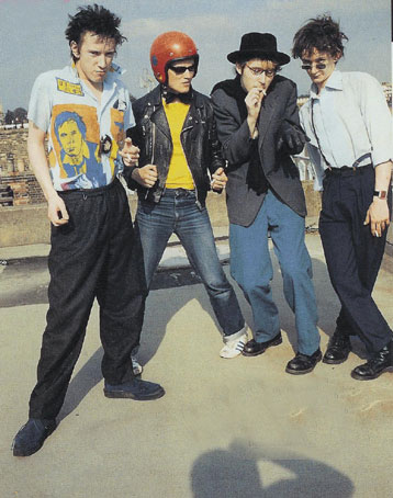 Lydon, Walker, Wobble & Levene on roof of Gunter Grove, 1978 © Dennis Morris